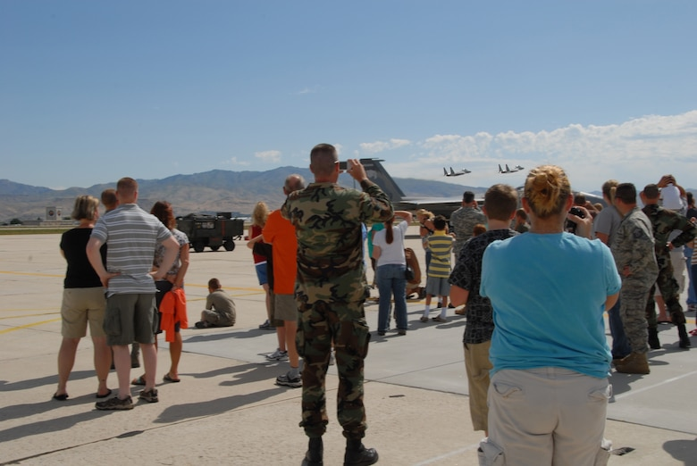 Many civilians and members of the Idaho Air and Army Guard watch two F-15 aircraft fly out of Gowen Field Air Base during a tour of an Oregon Air Guard 173 Fighter Wing aircraft on July 12, 2009. (Air Force photo by Tech Sgt Becky Vanshur)(Released)