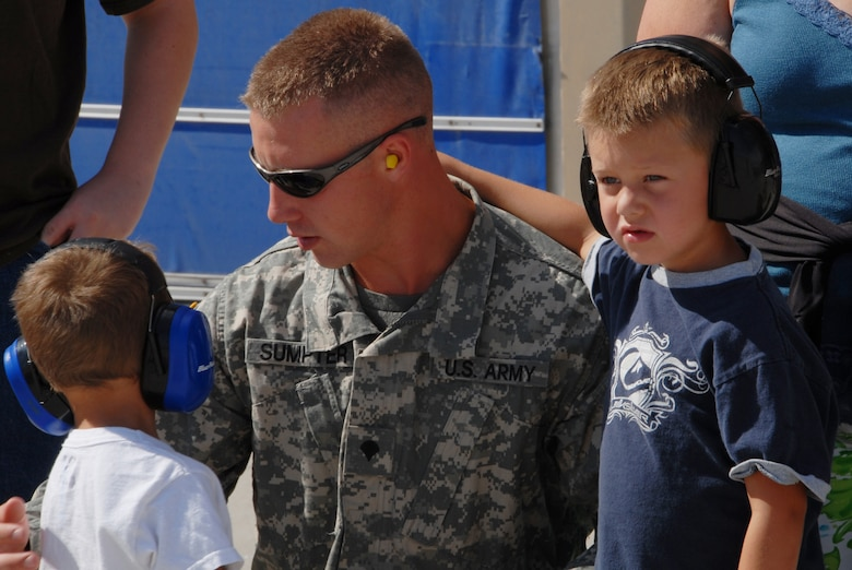 Specialist Sumpter from the Idaho Army National Guard and his two sons watch F-15 aircraft fly out of Gowen Field Air Base during a tour of an Oregon Air Guard 173 Fighter Wing aircraft on July 12, 2009. (Air Force photo by Tech Sgt Becky Vanshur)(Released)