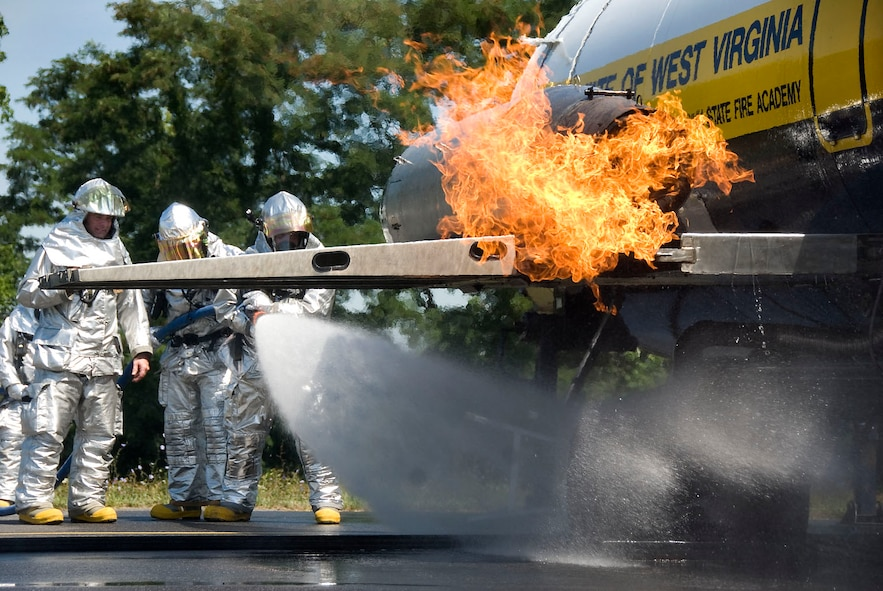 167th Airlift Wing firefighters extinguish a fire in the landing gear of a simulated aircraft during a training exercise at the Martinsburg, WVa air base on Wednesday, July 15, 2009. The West Virginia State Fire Academy provided the training for firefighters to become certified on Aircraft Firefighting or ARFF which is an annual requirement. (U.S. Air Force photo by Master Sgt Emily Beightol-Deyerle)