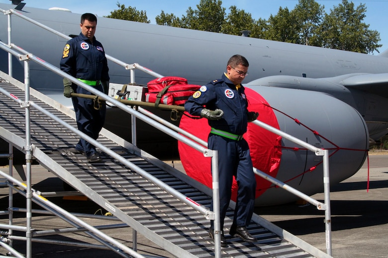 Turkish team members carry a gurney down the Patient Loading System ramp during aeromedical evacuation events for Air Mobility RODEO 2009 at McChord Air Force Base, Wash., July 20, 2009. More than 100 teams are participating in RODEO competition, including teams from seven foreign countries. RODEO is the U.S. Air Force's and AMC's premier air mobility competition. It's an international combat skills and flying operations competition designed to develop and improve techniques, procedures and interoperability with international partners to optimize mobility partnerships and enhance mobility operations. (U.S. Air Force Photo/Tech. Sgt. Scott T. Sturkol)