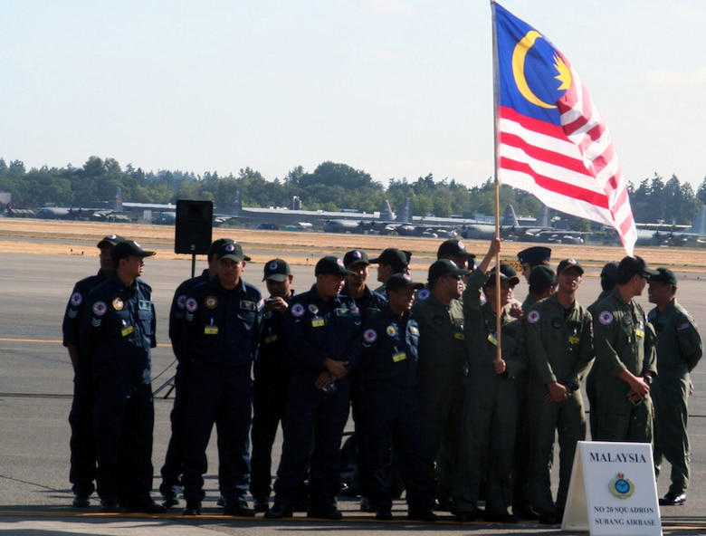 Members of the Malaysian team prepare for opening ceremonies for Air Mobility Command's RODEO 2009 July 19 at McChord Air Force Base, Wash.  More than 100 teams are participating in RODEO competition, including teams from seven foreign countries. RODEO is the U.S. Air Force's and AMC's premier air mobility competition. It's an international combat skills and flying operations competition designed to develop and improve techniques, procedures and interoperability with international partners to optimize mobility partnerships and enhance mobility operations. (U.S. Air Force Photo/Tech. Sgt. Scott T. Sturkol)