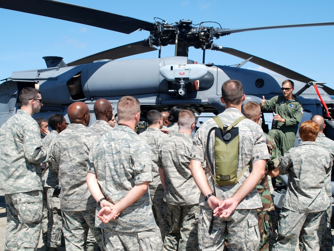 PATRICK AIR FORCE BASE, Fla. - Thirty nationwide Air Force Reserve chaplains gather around an HH-60G Pave Hawk helicopter as 920th Rescue Wing pilot Capt. Paul Carpenter gives them scenarios of his recent deployment to Afghanistan and discusses chopper capabilities.  The chaplains toured various Air Force bases in July to learn more about the variety of Air Force missions. The 920th Chaplain, Capt. Calvin Gittner, even tried recruiting someone to minister to the Rescue Wing Airmen to fill a void on his staff.  (U.S. Air Force photo/Capt. Cathleen Snow)