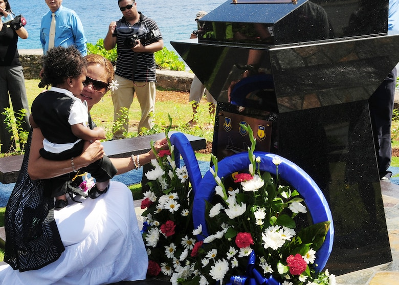 Ursula Martin, wife of Col. George Martin, and their son Guahan Martin lay a wreath at the base of the RAIDR 21 Monument at the Governor's Complex at Adelup Point in Hagatna, Guam, July 20.  They placed the wreath in remembrance of the husband and father they lost July 21, 2008, when a B-52 Stratofortress -- call sign RAIDR 21 -- crashed off the coast of Guam during a mission.  Colonel Martin was one of six crewmembers who perished.  More than 300 family, friends and guests attended the ceremony and monument unveiling.  (U.S. Air Force photo/Senior Airman Nichelle Anderson)