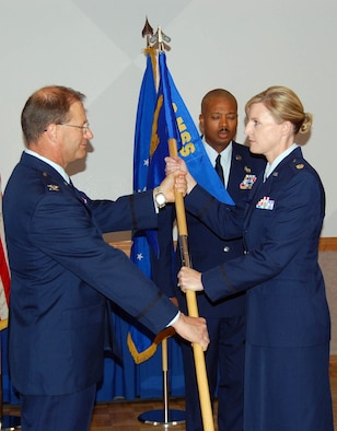Maj. Amy Boehle, 926th Mission Support Squadron commander, receives the guidon from Col. Herman Brunke, 926th Group commander, during the squadron's assumption of command ceremony July 10. (photo courtesy of 926th Mission Support Squadron)