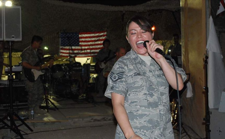 ? U.S. Air Force Staff Sgt. Angie Long  performs for U.S. and Coalition forces at a deployed location in Southwest Asia on July 7.  As the lead female vocalist of the AFCENT Band Mirage, she has performed for military personnel supporting both Operations Iraqi Freedom and Enduring Freedom.   Sergeant Long, who is deployed from the Air National Guard Band of the Central States in Missouri, hails from St. Louis. (Photo by Lt. Col. Reid Christopherson)