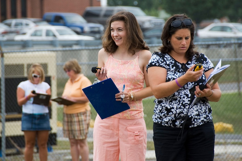 Berkeley County teachers Erin Sponaugle and Jennifer Higginbotham use GPS devices to track the coordinates of their location as part of an activity designed to measure the circumference of the earth, during a teachers workshop hosted by Martinsburg  STARBASE at the 167th Airlift Wing, Martinsburg West Virginia,  July 17, 2009. (U.S. Air Force photo by Master Sgt Emily Beightol-Deyerle)