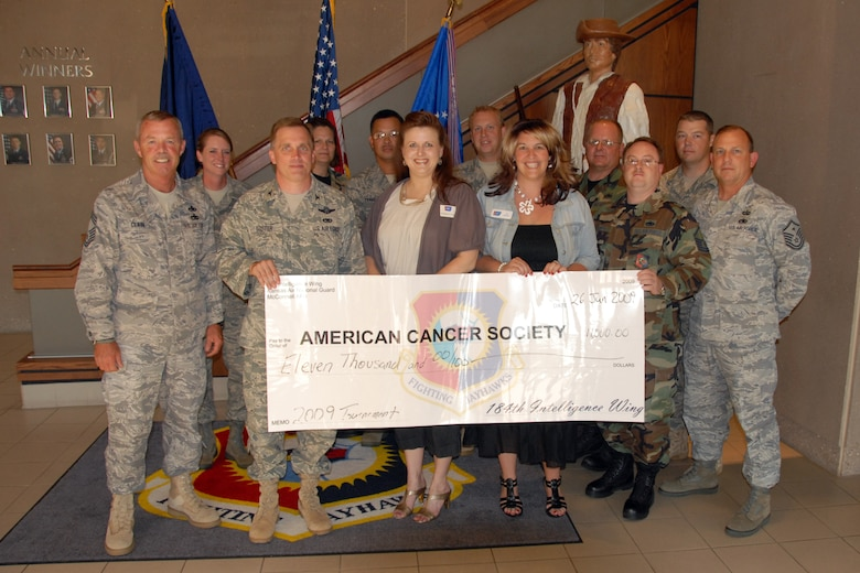 On June 11, Colonel Mike Foster, Commander of the 184th Intelligence Wing, Kansas Air National Guard, presented a $11,000 check to Elisabeth Cord of the American Cancer Society. The money was raised at the Wing's Annual Cancer Golf Tournament held this year at Hidden Lakes Golf Course.  The 184 IW and the Lyle Houghton Cancer Golf Committee have raised in excess of $190,000 over the last 23 years.