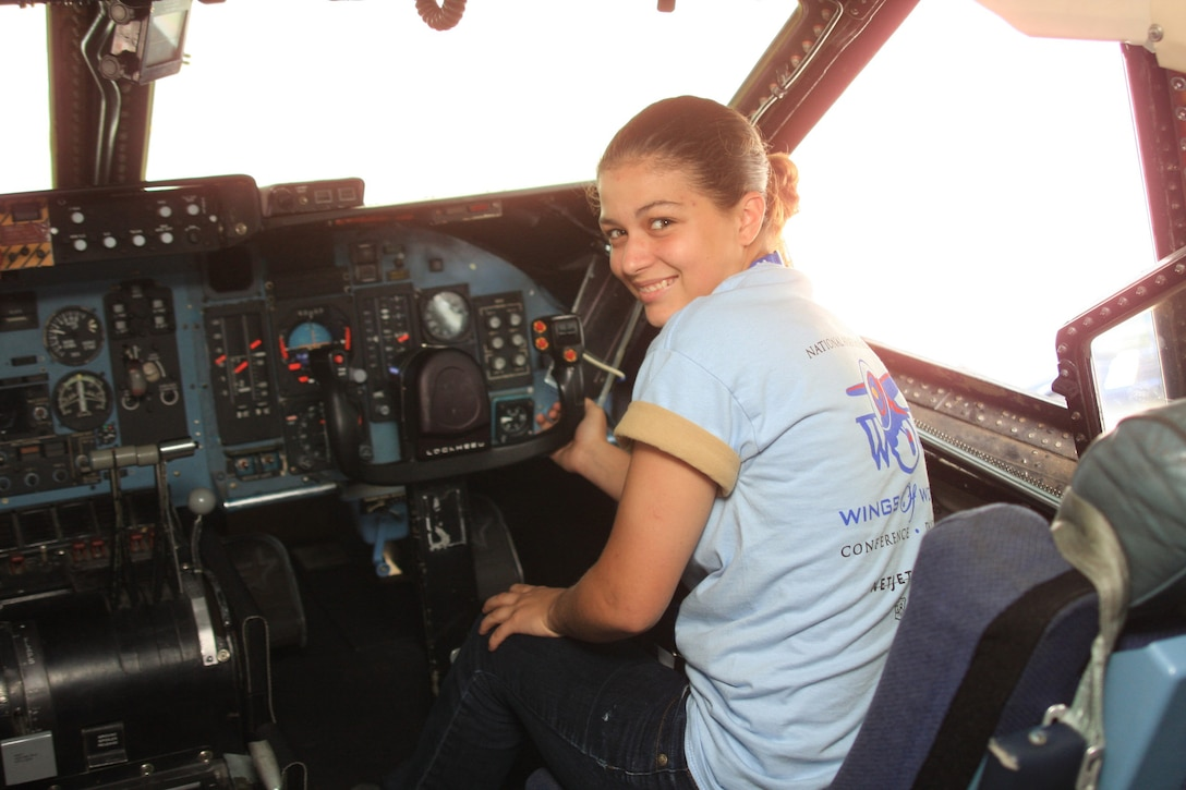 WRIGHT-PATTERSON AIR FORCE BASE, Ohio - Angel Buzard enjoys the view from the flight deck of a C-5 Galaxy aircraft.  Ms. Buzard and 45 other young women in grades 9-12 attended the Third Annual Wings of Women Conference July 17.  Part of the day-long event included a stop at the 445th Airlift Wing for a wing mission briefing, 445th Aeromedical Evacuation Squadron presentation and C-5 tour.  (Air Force photo/Senior Airman Mikhail Berlin)