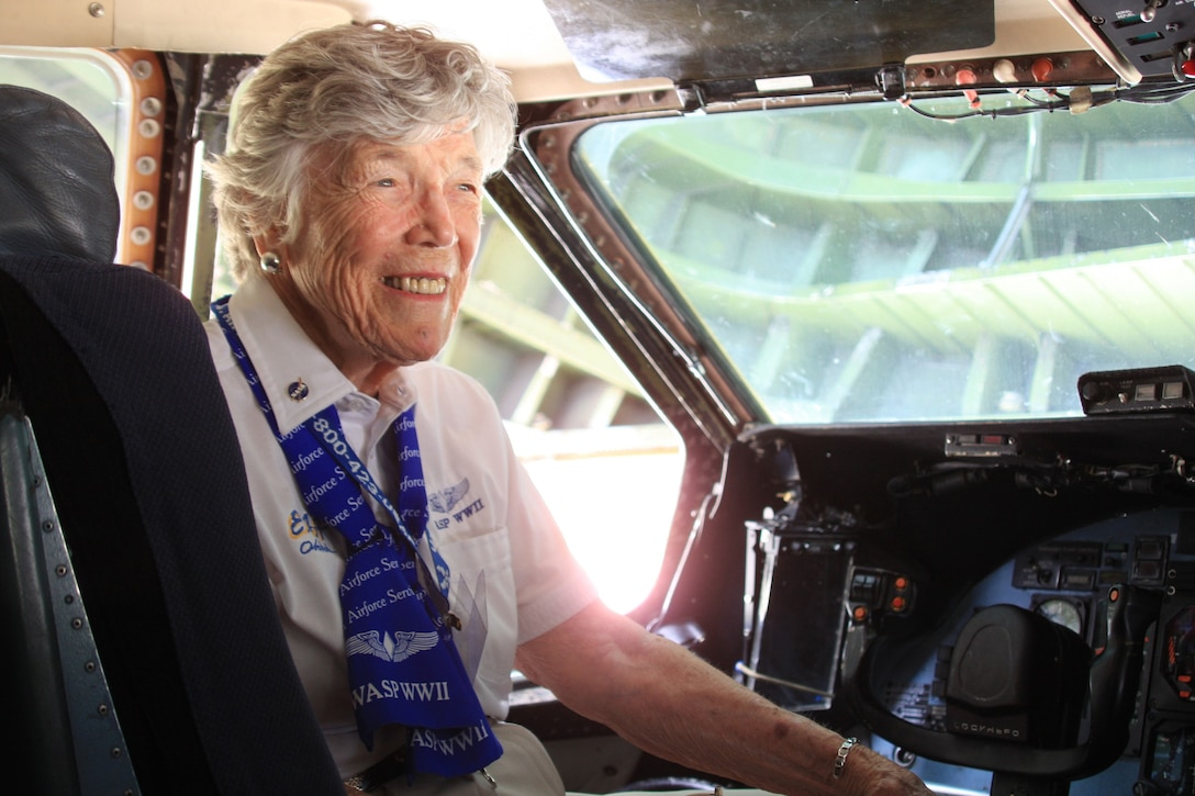 WRIGHT-PATTERSON AIR FORCE BASE, Ohio - Dawn Seymour, World War II Women Airforce Service Pilots (WASP), tours the flight deck of a 445th Airlift Wing C-5 Galaxy aircraft.  Four WASPs were special guests of the July 17 Third Annual Wings of Women Conference attended by 46 young women in grades 9-12.  Part of the day-long event included a stop at the 445th Airlift Wing for a wing mission briefing, 445th Aeromedical Evacuation Squadron presentation and C-5 tour.  (Air Force photo/Senior Airman Mikhail Berlin)