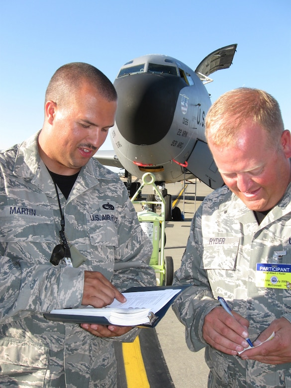 MCCHORD AFB, Wash. -- Tech. Sgt. Billy Martin and Master Sgt. Al Ryder, 931st Aircraft Maintenance Squadron, review technical orders for properly removing an accumulator.  Sergeant Ryder is the team chief for Team McConnell's RODEO maintenance team.  The RODEO maintenance competition consists of three separate maintenance ground events: preflight inspection, aircraft refueling and basic post flight. (Photo by Tech. Sgt. Chyrece Campbell)