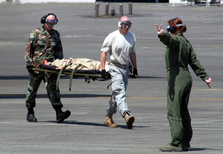 Teams competing in the aeromedical evacuation events for Air Mobility Rodeo 2009 wait in line as the competition commences July 20 at McChord Air Force Base, Wash. More than 100 teams are participating in Rodeo competition, including teams from seven foreign countries. Rodeo is the Air Force's and AMC's premier air mobility competition. It's an international combat skills and flying operations competition designed to develop and improve techniques, procedures and interoperability with international partners to optimize mobility partnerships and enhance mobility operations. (U.S. Air Force Photo/Tech. Sgt. Scott T. Sturkol)
