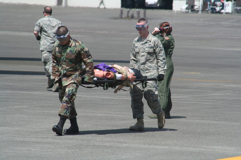 Teams compete in the aeromedical evacuation events for Air Mobility Rodeo 2009 July 20 at McChord Air Force Base, Wash. More than 100 teams are participating in RODEO competition, including teams from seven foreign countries. RODEO is the Air Force's and AMC's premier air mobility competition. It's an international combat skills and flying operations competition designed to develop and improve techniques, procedures and interoperability with international partners to optimize mobility partnerships and enhance mobility operations. (U.S. Air Force Photo/Tech. Sgt. Scott T. Sturkol)