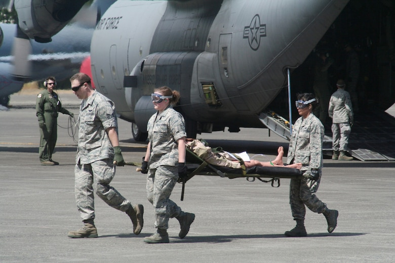 Teams compete in the aeromedical evacuation events for Air Mobility Rodeo 2009 July 20 at McChord Air Force Base, Wash. More than 100 teams are participating in Rodeo competition, including teams from seven foreign countries. Rodeo is the Air Force's and Air Mobility Command's premier air mobility competition. It's an international combat skills and flying operations competition designed to develop and improve techniques, procedures and interoperability with international partners to optimize mobility partnerships and enhance mobility operations. (U.S. Air Force photo/Tech. Sgt. Scott T. Sturkol)