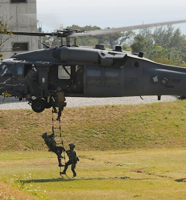 Pararescuemen assigned to the 31st Rescue Squadron at Kadena Air Base, Japan, climb into an HH-60G Pave Hawk helicopter during exercise Cope Angel 09-1 in Japan. (U.S. Air Force photo/Airman 1st Class Chad Warren)