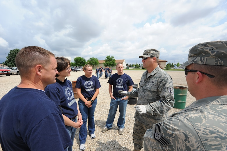 TSgt Micheal Clement explains the role these four members of the Idaho Air Guard Student Flight will participate in the flag disposal ceremony. From left to right Jeremy Johnson, Heidi Caye, Lindsay Coggins and Nicholas Jenson assisted the 124th Wing Honor Guard in the ceremony on June 9th, 2008 at Gowen Feild Air Base. These four members are highly interested on being members of the 124th Honor Guard after they have returned to the Wing from Basic Military Training.(Air Force photo by Staff Sgt Robert Barney)(Released)