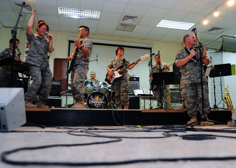 SOUTHWEST ASIA -- The Air Force Central Command band Sanora rocks out for members of the 386th Air Expeditionary Wing July 21. The concert is part of a month-long trip throughout the region. The band will travel to Camp Bucca, Iraq, before heading back to the states. (U.S. Air Force photo/Tony Tolley)