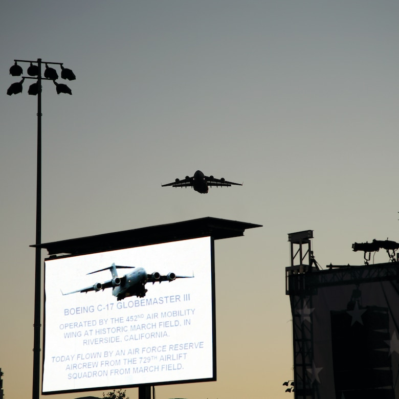 """A C-17 from the 729th Airlift Squadron at March ARB dips to 1,000 feet to fly over the City of Corona's """"July 4 Celebration"""" at Santana Park. The flyover was the last in a continuous series of 10 flyovers that day. (Photo courtesy of the City of Corona)"""