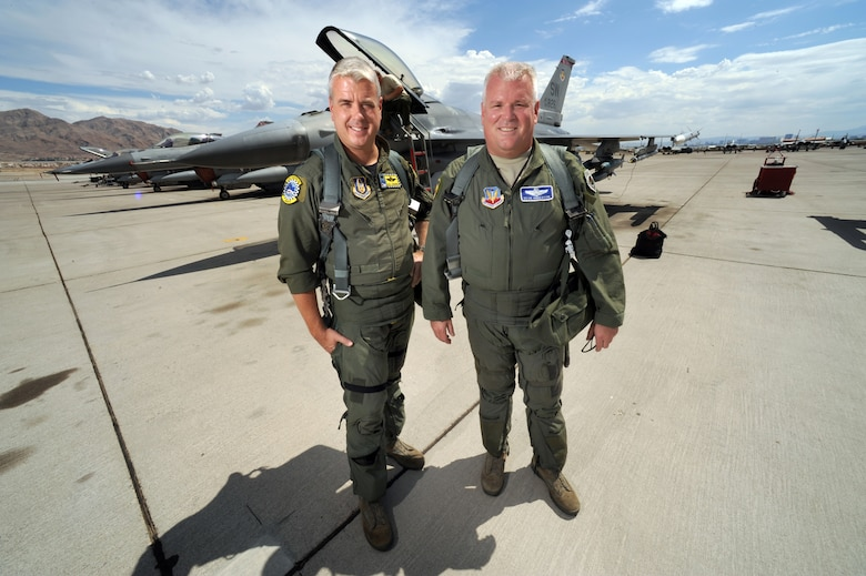 """Colonel Dean """"Norm"""" Anderson, 20th Fighter Wing vice commander at Shaw Air Force Base, S.C., and his younger brother,  Lt. Col. Ross """"Rosco"""" Anderson, 482nd FW Operations Group commander and full-time reservist at Homestead Air Reserve Base in Homestead, Fla. Pose for a portrait on the Nellis AFB, Nev., flight line to signify the first time two brothers have been in command together at a Red Flag exercise.  The brothers were given the unique opportunity to take command of the Air Expeditionary Wing at the Red Flag 09-4 exercise in Las Vegas. Col. Anderson, serving as the Red Flag AEW commander and Lt. Col. Anderson, as the Red Flag AEW Operations Group commander.  """"It's a huge honor, and a very big deal to me to be able to do this with my brother in a leadership position,"""" said Lt. Col. Anderson. """"Flying side by side in a squadron is one thing, but commanding is a huge honor."""" (U.S. Air Force photo/Tech. Sgt. Michael R. Holzworth)"""