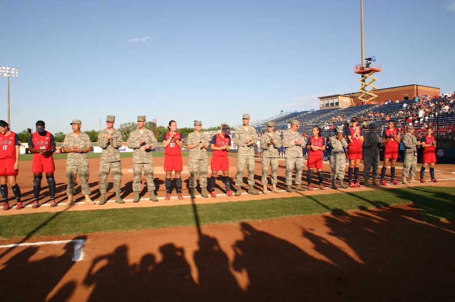 Ten Airmen from the 552nd Air Control Wing were introduced along with the Team USA players as part of Military Appreciation Night at the World Cup of Softball July 17.