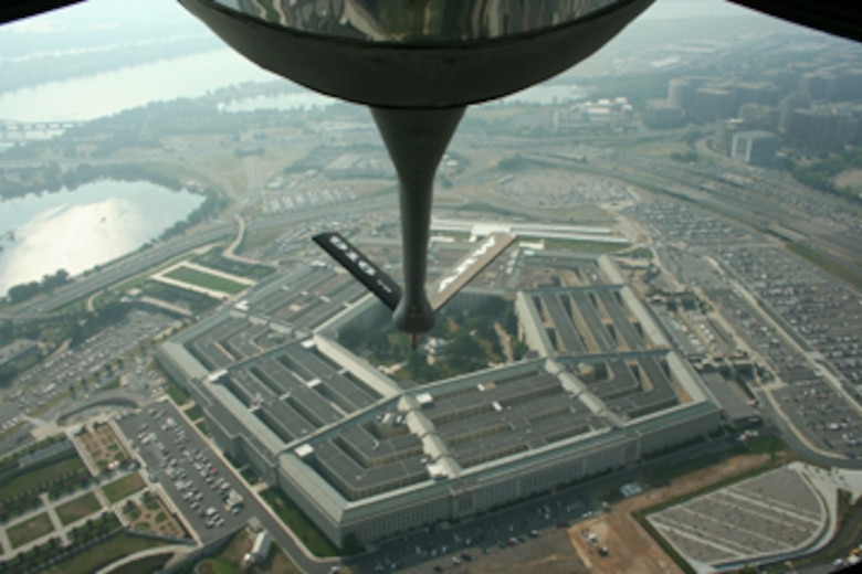 SEYMOUR JOHNSON AIR FORCE BASE, N.C. -- A KC-135 Stratotanker from the 916th Air Refueling Wing flies over the Pentagon on its way to a ceremony at Arlington National Cemetery on July 22. The fly-over was to honor service members from Vietnam that were changed from missing in action to killed in action. (U.S. Air Force photo by: Tech. Sgt. Jonathan Taylor, 911th Air Refueling Squadron)