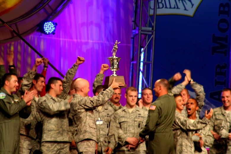 "Members of the 62nd Airlift Wing, McChord Air Force Base, Wash., hold up the trophy for winning Best Air Mobility Team for Air Mobility RODEO 2009 July 24, 2009, at McChord AFB. The award is considered the ""Best of the Best"" in RODEO competition.  (U.S. Air Force Photo/Tech. Sgt. Scott T. Sturkol)"