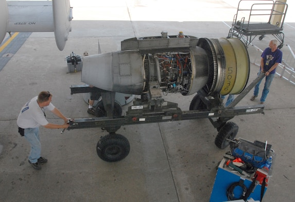 Bob Boye, left, and John Ezell move an engine trailer after removing a TF-34-100A turbo-fan engine from an A-10 Thunderbolt II at Whiteman Air Force Base, Mo., June 2, 2009.  This engine set a longevity record in the 442nd Fighter Wing for being on the same airplane for 10 years and lasted through 3,464.4 hours of operating time.  The engine is a TF-34-100A engine manufactured by General Electric.  Both men are crew chiefs with the 442nd Aircraft Maintenance Squadron, part of the 442nd Fighter Wing, an Air Force Reserve A-10 unit based at Whiteman.  (U.S. Air Force photo/Master Sgt. Bill Huntington)