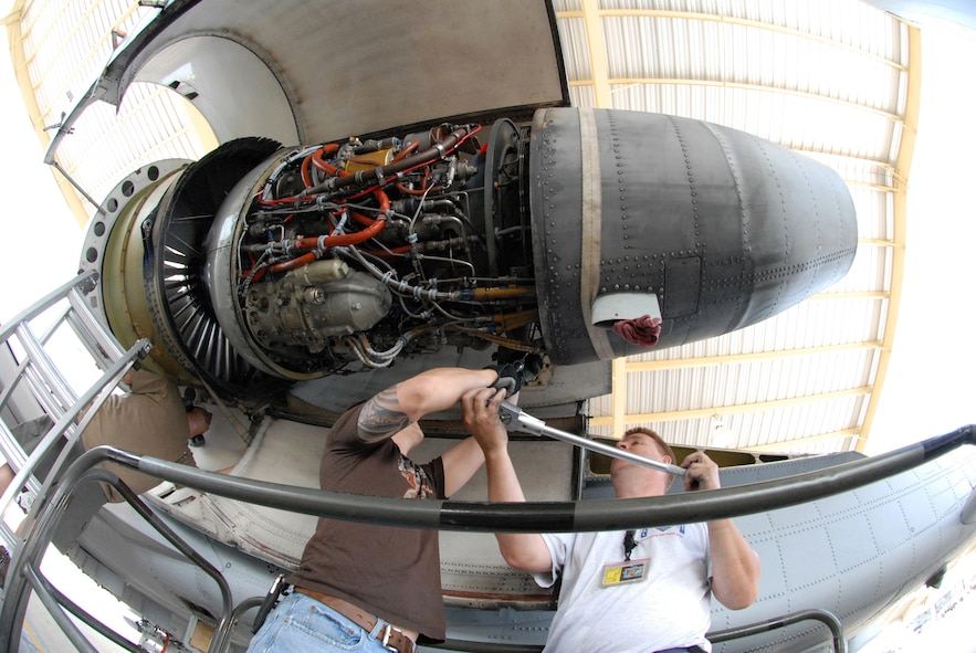 David Greenburg and Bob Boye loosen a bolt to remove a TF-34-100A turbo-fan engine from an A-10 Thunderbolt II at Whiteman Air Force Base, Mo., June 2, 2009, while Tony Divito, left, checks a safety strap.  This engine set a longevity record in the 442nd Fighter Wing after being installed on the same aircraft for 10 years and accumulated 3,464.4 hours of operating time.  Mr. Boye and Mr. Greenberg are crew chiefs in the 442nd Aircraft Maintenance Squadron and Mr. Divito is an engine mechanic in the 442nd Maintenance Squadron.  All three are Air Reserve Technicians.  The 442nd is an Air Force Reserve unit based at Whiteman.  (U.S. Air Force photo/Master Sgt. Bill Huntington)