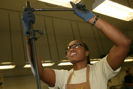 Tech. Sgt. Margery Martin, 575th Combat Sustainment Squadron, installs the barrel of an M16a2 assault rifle receiver at the gunsmith shop on Lackland's Training Annex. The only gunsmith shop in the Air Force, it focuses on the transfer of Marine and Army M16a2 assault rifles into the hands of Airmen. (U.S. Air Force photo/Robbin Cresswell)