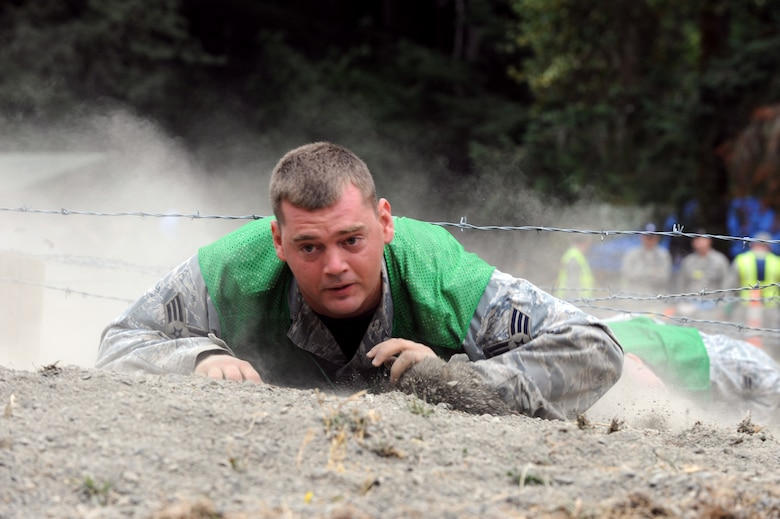 Senior Airman Nathan Shelley low crawls through an obstacle during a combat endurance competition on July 23 at RODEO 2009. Airman Shelley is a Reservist assigned to the 931st Air Refueling Group at McConnell Air Force Base, Kan. His security forces teammates at RODEO are active-duty Airmen assigned to the 22nd Air Refueling Wing, the 931st's host unit at McConnell. Eight Reservists are at McChord AFB, Wash., with 22nd ARW Airmen to represent McConnell as a total-force RODEO team for the first time. (U.S. Air Force photo/Tech. Sgt. Chyrece Campbell)