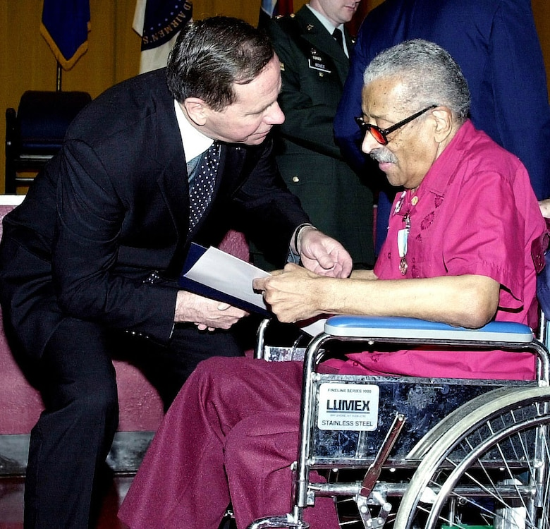Recognition might come many years after the events. Here, Maj. Gen. (Ret.) Nels Running congratulates Eugene Mundy, who had just received the Korean War Service Medal from the Republic of Korea during a ceremony at the U.S. Soldiers' and Airmen's Home in Washington, D.C., in April 2001. Mundy, who served in the Air Force during the Korean War, was one of 34 veterans honored that day as part of the 50th anniversary of the Korean War. (U.S. Air Force photo)