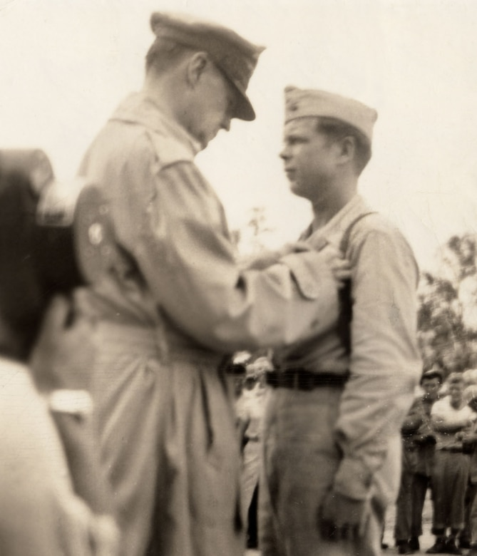 Gen. Douglas MacArthur presents the Medal of Honor to Maj. Richard Bong in December 1943. Bong was America's highest scoring ace in World War II. (U.S. Air Force photo)
