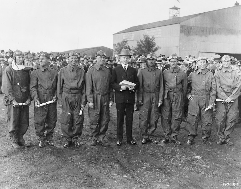 President Calvin Coolidge presents Distinguished Flying Cross citations to the Pan American Fliers on May 2, 1927. The first to circumnavigate South America by air, they were (left to right): 1st Lt. Charles Robinson, Capt. Arthur McDaniel, 1st Lt. Ennis Whitehead, Maj. Herbert Dargue, President Coolidge, Capt. Ira Eaker, 1st Lt. Muir Fairchild, 1st Lt. Bernard Thompson and 1st Lt. Leonard Weddington. They received the actual medals at a later date. (U.S. Air Force photo)