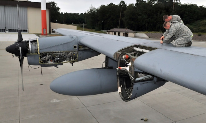 U.S. Air Force Airmen from the 86th Maintenance Squadron perform an isochronical inspection on a C-130E Hercules, July 22, 2009, Ramstein Air Base, Germany. This is the final ISO inspection on the C-130E Hercules on Ramstein as the base continues to replace the C-130E with the new C-130J Super Hercules. (U.S. Air Force photo by Senior Airman Nathan Lipscomb)