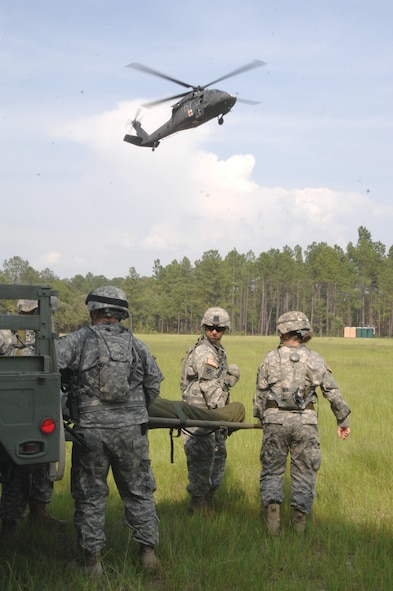 Fort Gordon, Ga. U.S. Army medical personnel from the 628th Forward Surgical Team, San Antonio, Texas, prepare to medically evacuate a simulated injured soldier onto a UH-60 Blackhawk on June 11. (U.S. Air Force photo by Technical