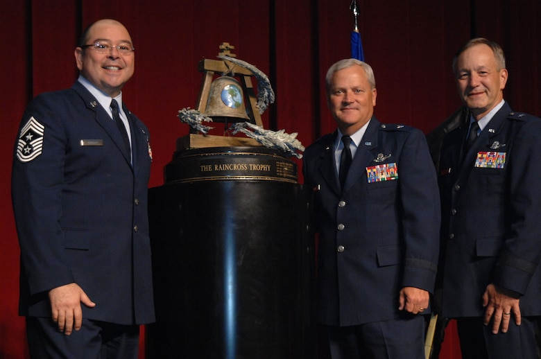 Chief Master Sgt. Agustin Huerta, 452nd Air Mobility Wing Command Chief, March Air Reserve Base, Calif.  left, Brig. Gen. James Melin, center, 452nd AMW Commander, and Brig. Gen. Eric W. Crabtree, right, Commander, Fourth Air Force, pose with the Raincross Trophy after it was awarded to the 452nd AMW during the 11th Annual Raincross Trophy Dinner held July 23, 2009, at the Riverside Convention Center, Riverside, Calif. The dinner is hosted by the Greater Riverside Chambers of Commerce Military Affairs Committee to honor and recognize the 11 wings and two groups in 4th Air Force.  (U. S. Air Force photo/Senior Master Sgt. Kim Allain)  (released)
