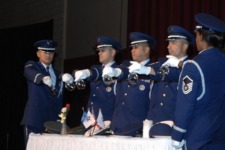 Six members of the Fourth Air Force Honor Guard invert glasses to remind us that our prisoners of war and those missing in action are with us in spirit at the 11th Annual Raincross Trophy Dinner held July 23, 2009, at the Riverside Convention Center, Riverside, Calilf. The dinner is hosted by the Greater Riverside Chambers of Commerce Military Affairs Committee to honor and recognize the 11 wings and two groups in Fourth Air Force.  (U. S. Air Force phot/Senior Master Sgt. Kim Allain)  (released)