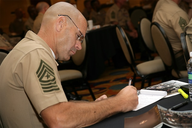 Sgt. Maj. Andrew L. Yagle, the sergeant major of Marine Corps Recruit Depot, Paris Island, S.C., takes notes during the 2009 Sergeant Major Symposium July 27. The week-long forum yielded discussion on an array of topics to include suicide prevention, family support and readiness and the Wounded Warrior Regiment.