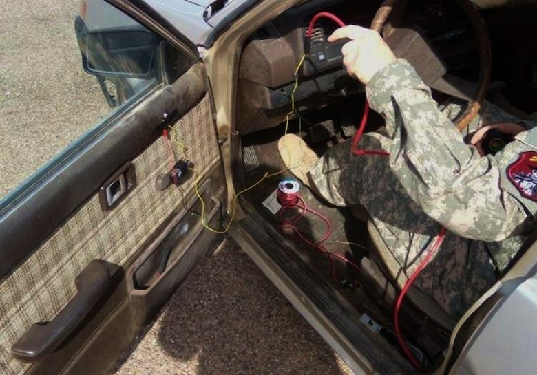 A Navy Weapons Intelligence Team member in training transforms a vehicle into a training vehicle borne improvised explosive device during a course March 13 at Fort Huachuca, Ariz. Potential WIT members received training in IED construction, fingerprinting, biometrics, foreign weapons, media exploitation and sensitive sight exploitation. (U.S. Air Force photo/Staff Sgt. Joshua Strang)