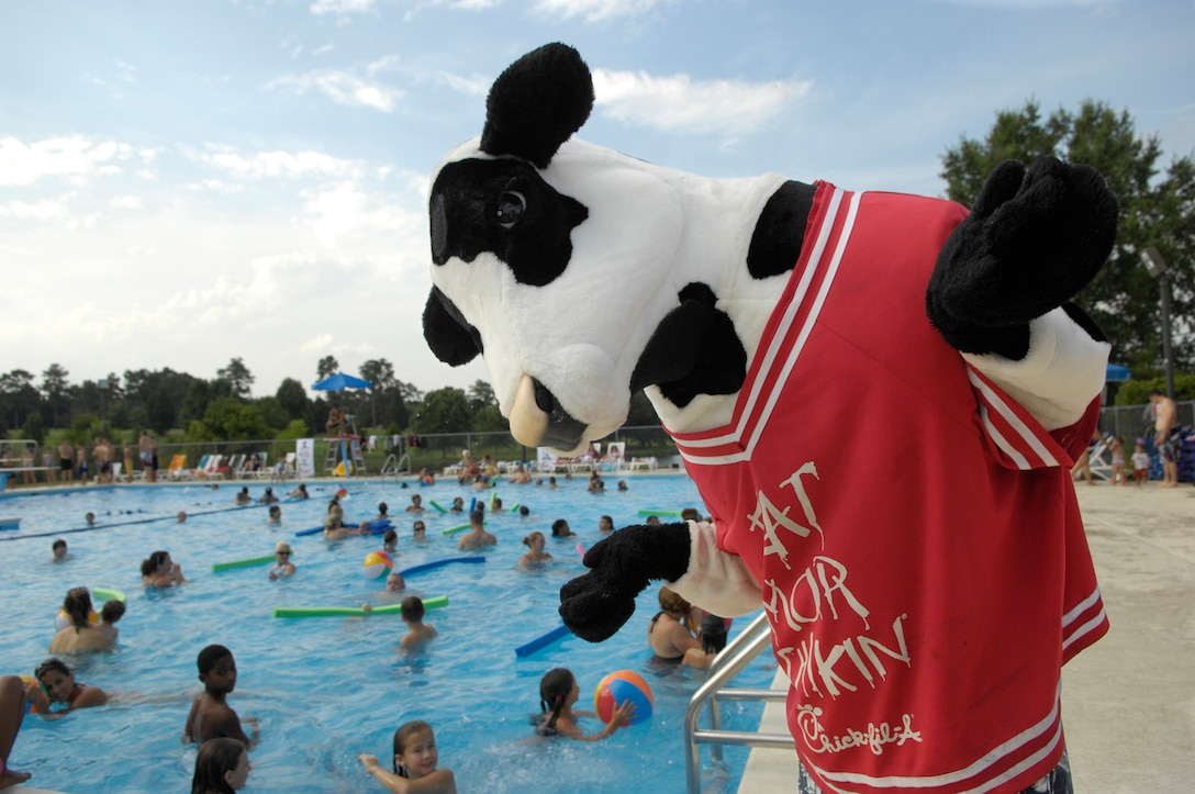 SHAW AIR FORCE BASE, S.C. -- Cow, the Chick-Fil-A mascot, makes an appearance at the Lakeside pool here, July 23. The Sumter Chick-fil-A marketing team sponsored a pool party and free food for Shaw Airmen and their families. (U.S. Air Force photo/Senior Airman Kathrine McDowell)