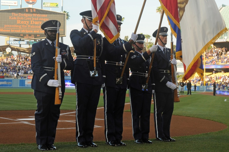An Honor Guard from Los Angeles AFB posted the colors at the Dodgers game, July 24. The base and El Segundo Chamber of Commerce teamed up again to offer discounted tickets to the game against the Florida Marlins. Officials from LAAFB and the City of El Segundo were introduced on the field prior to the game. (Photo by Atiba S. Copeland)