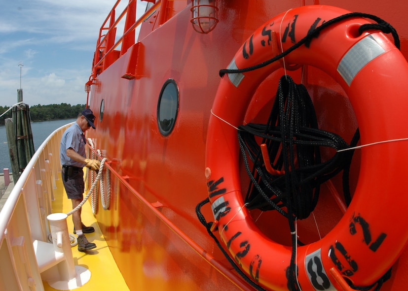Byron Howle secures a rope as the vessel leaves the docks July 22 at Tyndall Air Force Base, Fla. The boat is one of three 120-foot sea vessels owned by the Air Force used to recover sub-scale drones called BQM-167s after live-fire exercises over the Gulf of Mexico. The ships recover approximately 25 of the $800,000 drones each year. Mr. Howle is an 82nd Aerial Targets Squadron contractor with Florida Offshore. (U.S. Air Force photo/Samuel King Jr.)