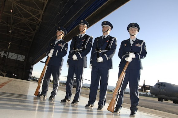 Base honor guard members from the 129th Rescue Wing, Moffett Federal Airfield, Calif., perform at a retirement ceremony at Moffett Field Feb. 7, 2009. (Air National Guard photo by Master Sgt. Dan Kacir)(RELEASED)