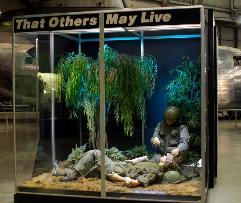 "DAYTON, Ohio - A Vietnam-era USAF pararescuman, or ""PJ,"" prepares a wounded soldier for helicopter evacuation in a diorama in the Southeast Asia War Gallery. PJs often descended into combat situations to aid the wounded. (U.S. Air Force photo)"