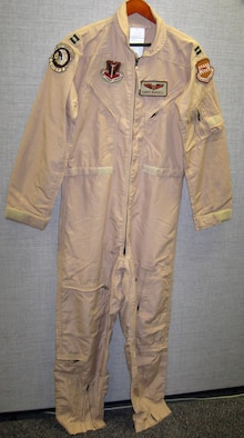 These coveralls were worn by the donor, who flew an emergency close air support mission on March 4, 2002, in his F-15E to defend the Special Operations team on the mountain Takur Ghar in Afghanistan. (U.S. Air Force photo)