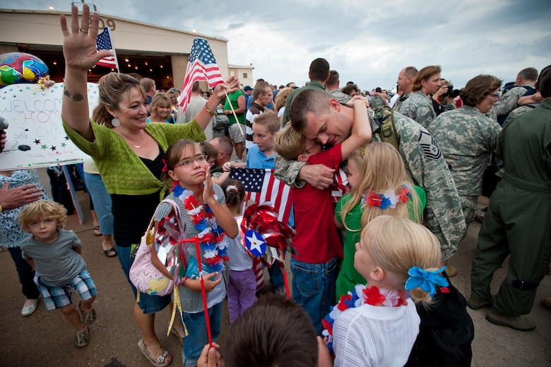 Air Force Master Sgt. Ray Carter, aerospace ground equipment technician, 140th Wing, Buckley Air Force Base, Colorado Air National Guard, receives a joyous and tearful welcome home following his return from Joint Base Balad, Iraq. Master Sgt. Carter was deployed in support of Operation Iraqi Freedom. (U.S. Air Force photo/Master Sgt. John Nimmo, Sr.) (RELEASED)
