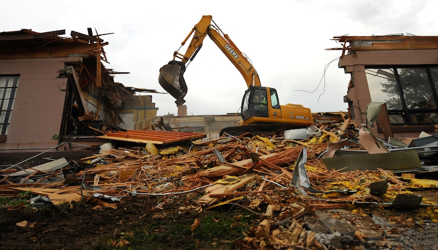 OFFUTT AIR FORCE BASE, Neb. -- Building 418 is demolished here July 27. The facility served numerous purposes including as an Airman's club, community center and military clothing sales store. U.S. Air Force Photo by Josh Plueger