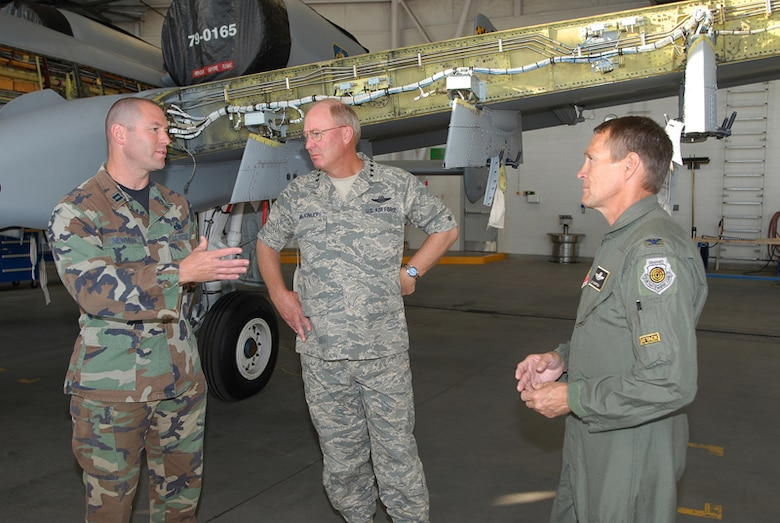 Colonel James Compton and Captain Eric Newman explain the modifications being made to an A-10 Thunderbolt II to Chief of the National Guard Bureau Gen Craig McKinley during a visit to Gowen Field in Boise, Idaho. Colonel Compton is the Commander of the 124th Wing and Captain Newman is a Maintenance Officer with the 124th Maintenance Squadron, Idaho Air National Guard in Boise.