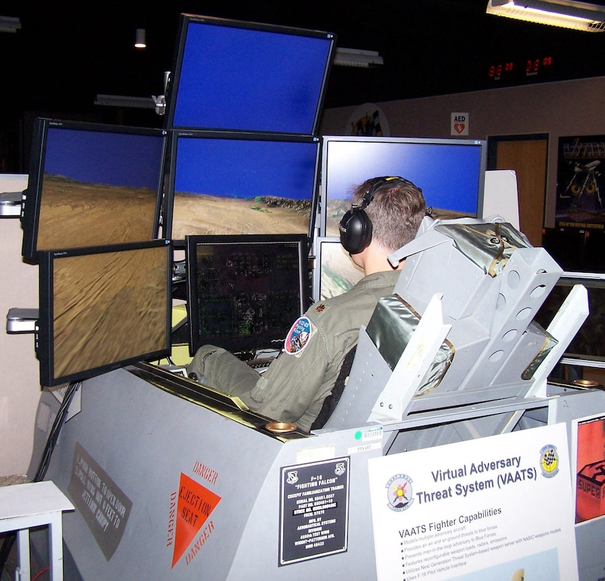 KIRTLAND AFB, N.M. -- Maj. Mike Shepherd, pilot and operations flight commander with the 64th Aggressor Squadron, uses a simulator to fly an SU-27 Soviet plane against an Air National Guard unit at the Distributed Missions Operation Center at Kirtland Air Force Base. The major was taking part in VIRTUAL FLAG 09-3 facilitated by the 705th Combat Training Squadron at Kirtland Air Force Base. (U.S. Air Force photo/Noel Getlin)