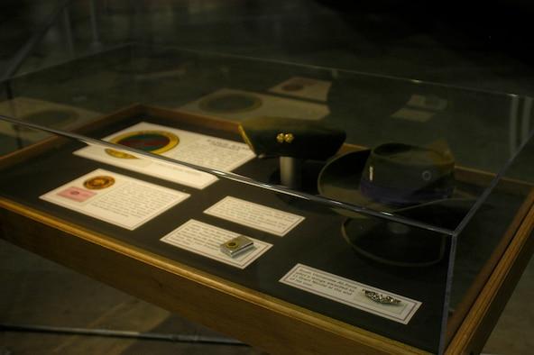 DAYTON, Ohio - Insignia, patch, lighter, hats and pilot's wings on display in part of the Down in the Weeds: Ranch Hand exhibit in the Southeast Asia War Gallery at the National Museum of the U.S. Air Force. (U.S. Air Force photo)