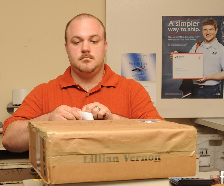 David Medus, U.S. Postal Service clerk, places a shipment stamp on a package on Seymour Johnson Air Force Base, N.C., July 24, 2009. If a package or letter is placed in the mail without the proper amount of stamps it will be returned to sender, this rarely occurs. (U.S. Air Force photo by Airman 1st Class Whitney S. Lambert)